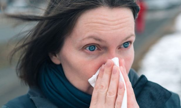 woman-eyes-wide-open-holding-tissue-to-nose-768